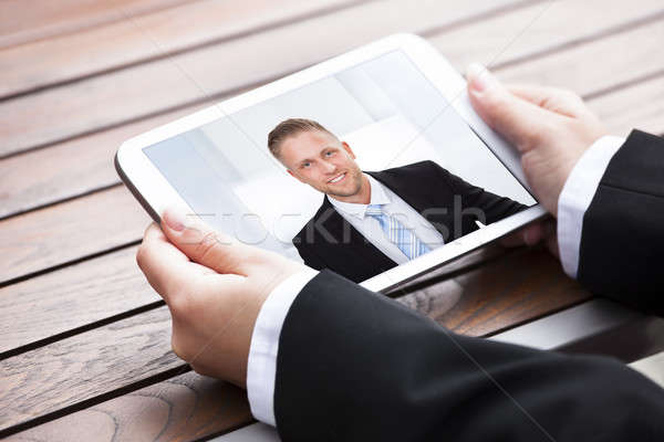 Businesswoman Video Conferencing With Colleague Stock photo © AndreyPopov