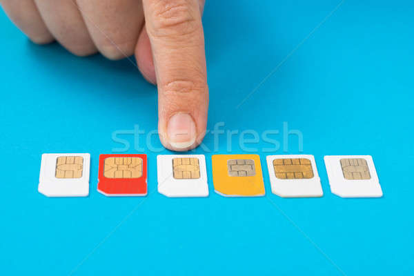 Person Hand Selecting Sim Card Stock photo © AndreyPopov
