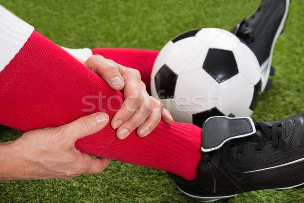 Gewond voetballer veld hand sport Stockfoto © AndreyPopov