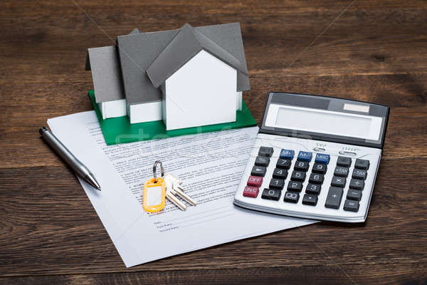 House Model On Contract Paper With Keys And Calculator Stock photo © AndreyPopov
