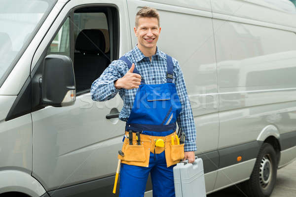 Repairman With Tools And Toolbox Showing Thumb Up Sign Stock photo © AndreyPopov