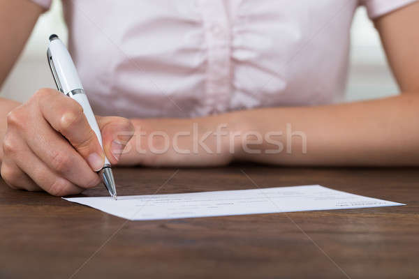 Person Hands Signing Cheque Stock photo © AndreyPopov