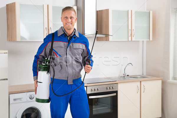 Pest Control Worker With Insecticide Sprayer Stock photo © AndreyPopov