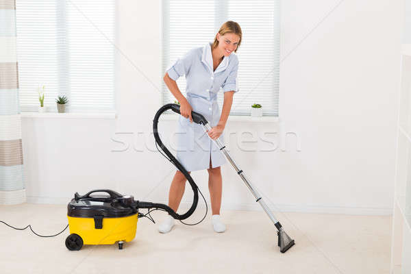 Female Maid Vacuuming Floor Stock photo © AndreyPopov
