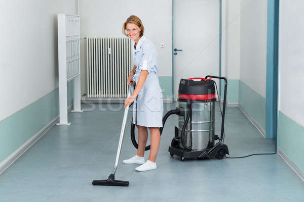 Female Cleaner Vacuuming Floor Stock photo © AndreyPopov