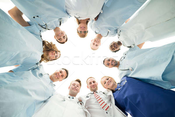 Portrait Of Confident Medical Team Standing In Huddle Stock photo © AndreyPopov