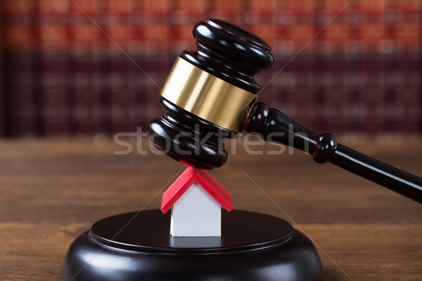 Wooden Mallet Being Hit On House Model Stock photo © AndreyPopov