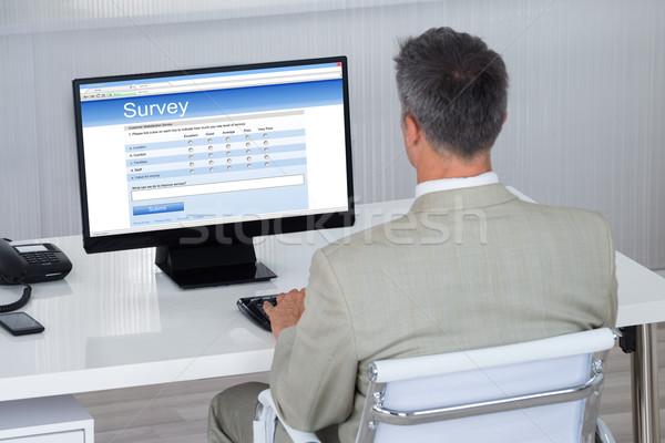 Foto d'archivio: Imprenditore · riempimento · sondaggio · forma · computer · desk