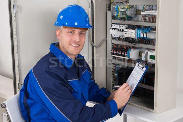 Young Male Technician Examining Fusebox Stock photo © AndreyPopov