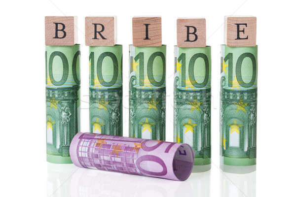 Bribe Blocks Arranged On Rolled Euro Notes Stock photo © AndreyPopov