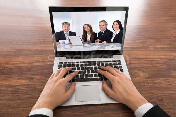 Close-up Of Businessman Video Conferencing On Laptop Stock photo © AndreyPopov