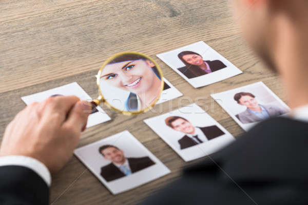 Businessman Viewing Candidates Through Magnifying Glass Stock photo © AndreyPopov