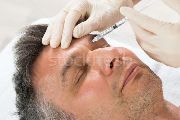 Adam kozmetik enjeksiyon şırınga olgun adam klinik Stok fotoğraf © AndreyPopov
