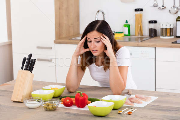 Unhappy Woman In Kitchen Stock photo © AndreyPopov