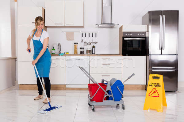 Woman Cleaning Kitchen Floor With Mop Stock photo © AndreyPopov