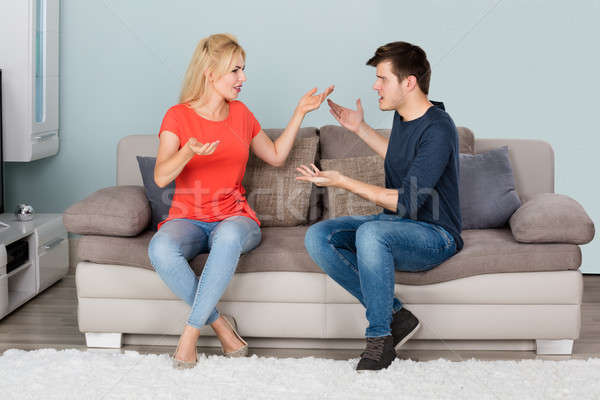 Couple Sitting On Couch Quarreling With Each Other Stock photo © AndreyPopov
