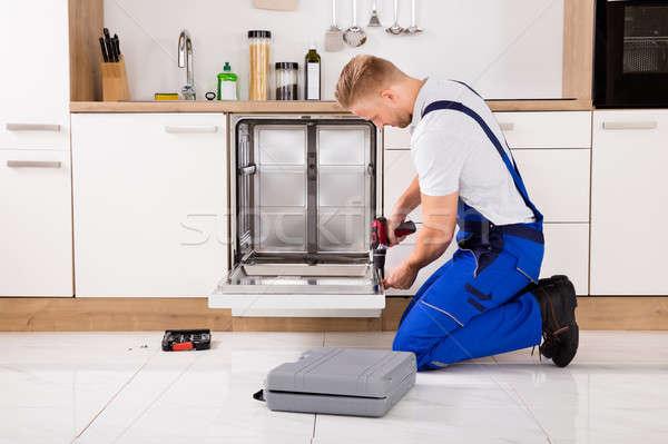 Repairman Repairing Dishwasher Stock photo © AndreyPopov
