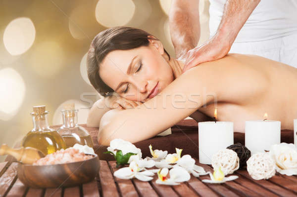 Stock photo: Relaxed Woman Receiving Shoulder Massage