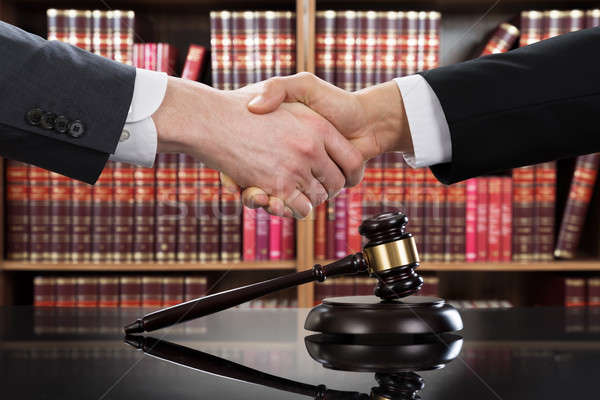 Gavel With Judge And Client Shaking Hands In Background Stock photo © AndreyPopov