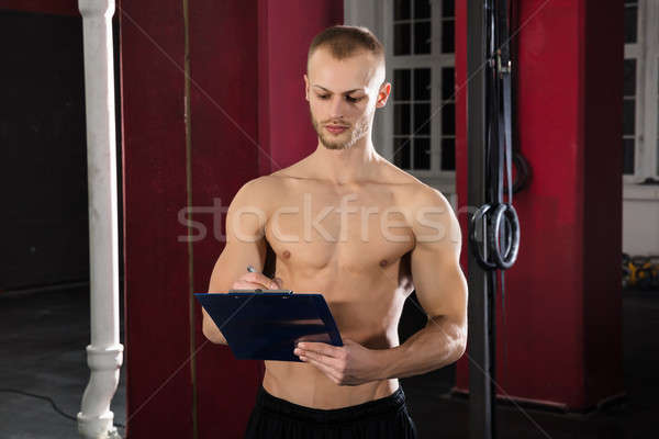 An Athlete Man With Clipboard In The Gym Stock photo © AndreyPopov