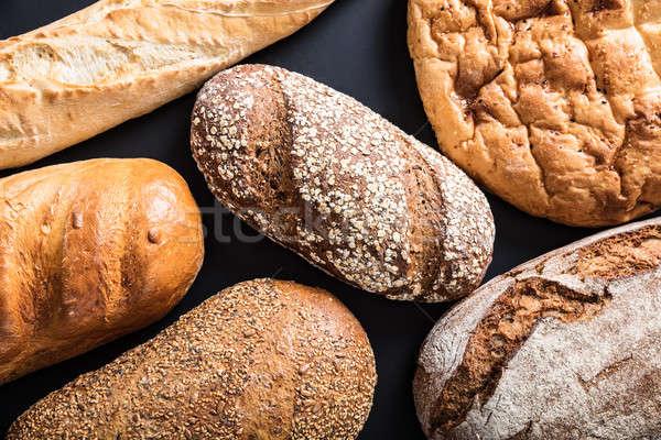 разнообразие хлеб черный фон Сток-фото © AndreyPopov