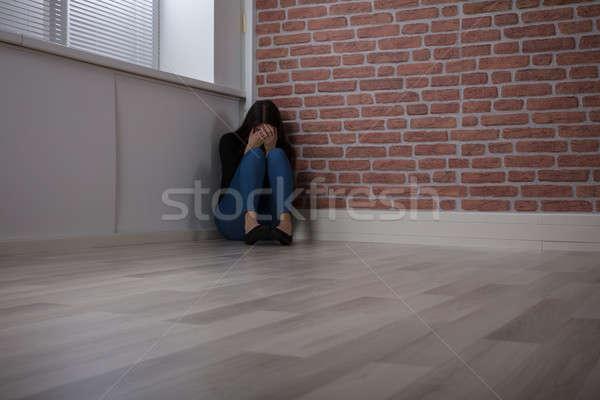 Kadın oturma köşe genç kadın oda korku Stok fotoğraf © AndreyPopov