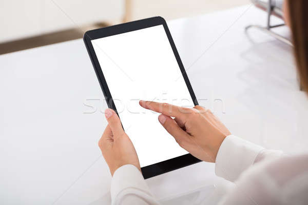 Businessperson Using Digital Tablet With Blank White Screen Stock photo © AndreyPopov