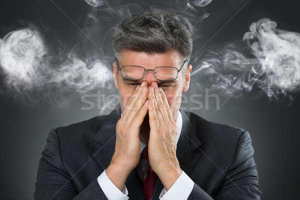 üzletember befogja száját füst portré fekete arc Stock fotó © AndreyPopov