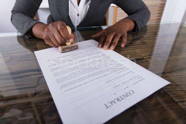Person's Hand Stamping On Approved Contract Form Stock photo © AndreyPopov
