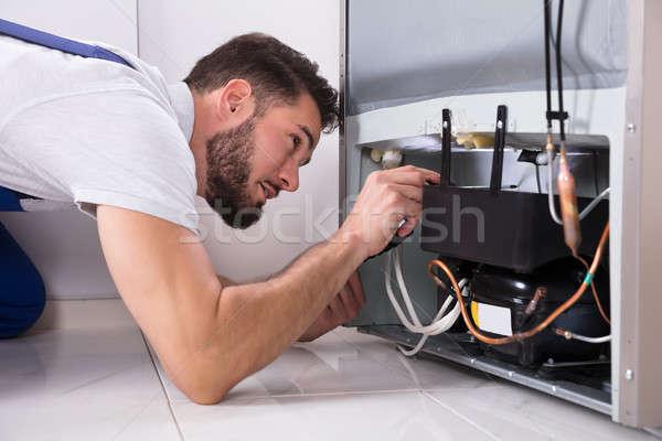 技術者 冷蔵庫 写真 男性 ストックフォト © AndreyPopov