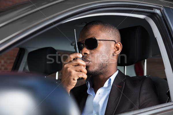 Man Sitting Inside Car Talking On Walkie Talkie Stock photo © AndreyPopov