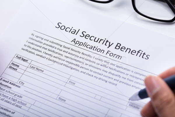Person Filling Social Security Benefits Application Form Stock photo © AndreyPopov