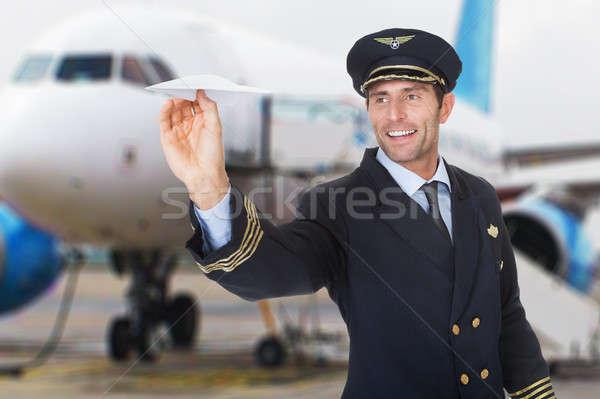 Pilota battenti carta ritratto sorridere maschio Foto d'archivio © AndreyPopov