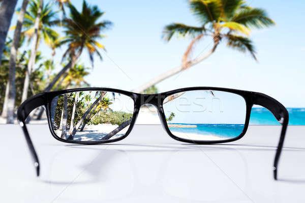 Playa palmeras gafas primer plano cielo Foto stock © AndreyPopov