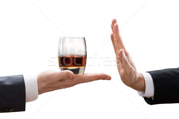 Stock photo: Businessperson Reject A Glass Of Whiskey Offered By Partner