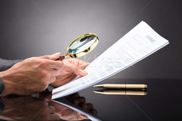 Judge Looking At Document With Magnifying Glass Stock photo © AndreyPopov