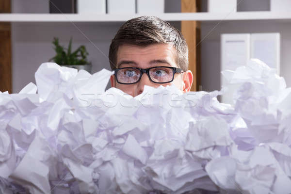 Businessman Looking At Heap Of Crumpled Paper Stock photo © AndreyPopov
