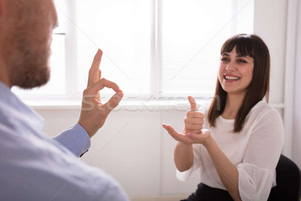 Stock photo: Young Woman And Man Talking With Sign Language