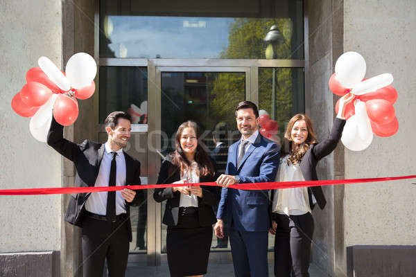 Businesspeople Cutting Red Ribbon Stock photo © AndreyPopov