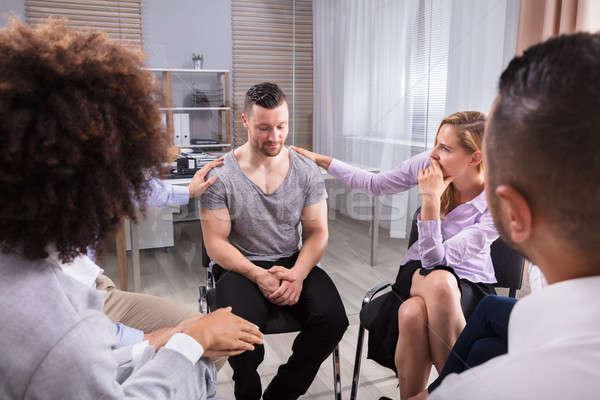 Két személy fiatalember csoport terápia nő férfi Stock fotó © AndreyPopov