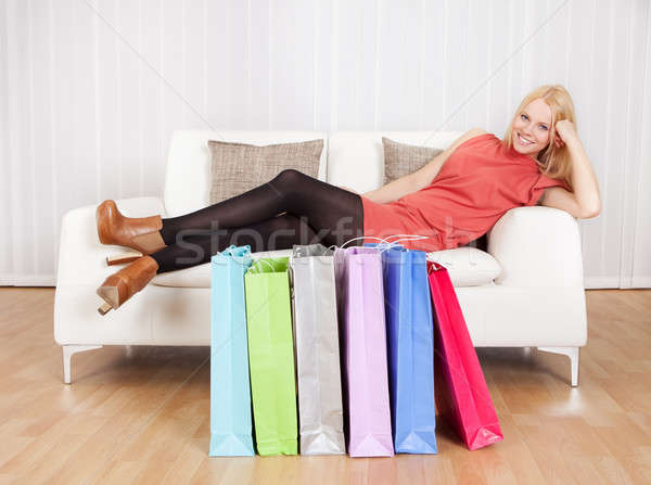 Beautiful young woman relaxing after shopping Stock photo © AndreyPopov