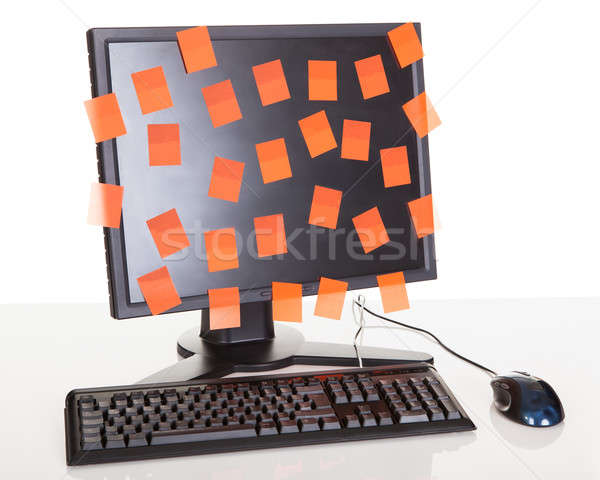 Computer screen covered in sticky notes Stock photo © AndreyPopov