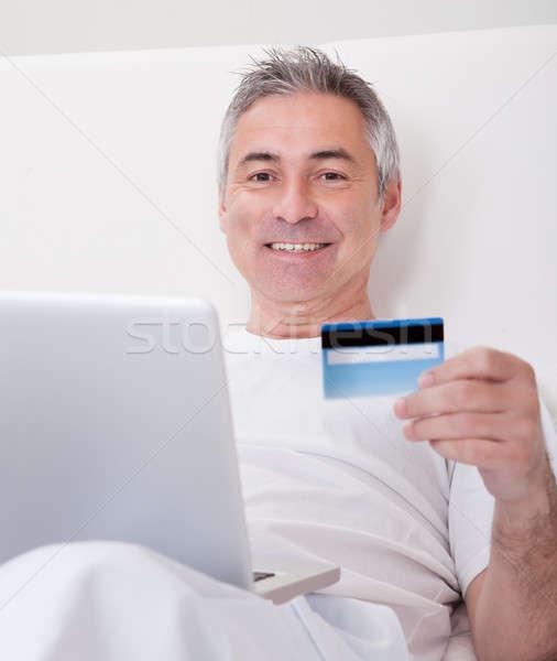зрелый человек торговых онлайн портрет счастливым компьютер Сток-фото © AndreyPopov