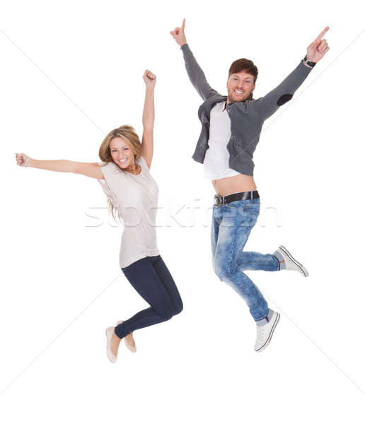 Jubilant young man and woman Stock photo © AndreyPopov
