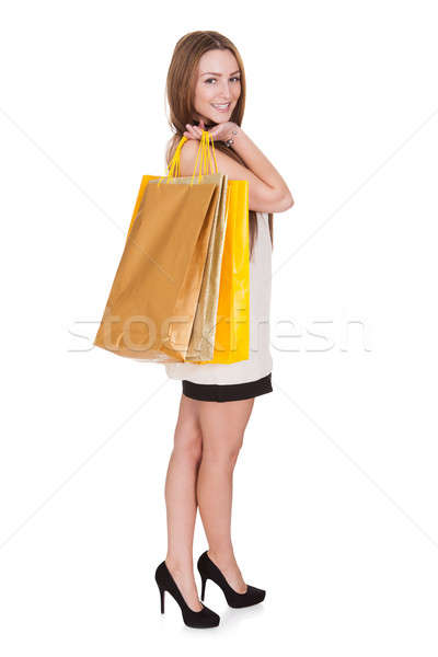 Happy Young Woman Holding Shopping Bags Stock photo © AndreyPopov