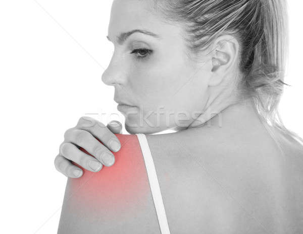 Mulher dor no ombro isolado branco mão Foto stock © AndreyPopov