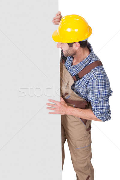 Construction worker presenting empty banner Stock photo © AndreyPopov