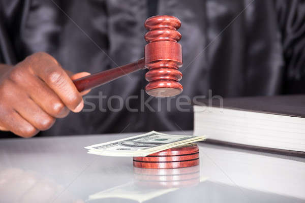 Striking The Gavel Dollar Note In A Courtroom Stock photo © AndreyPopov