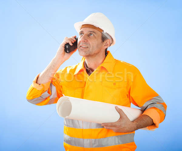 Senior construction worker on sky Stock photo © AndreyPopov