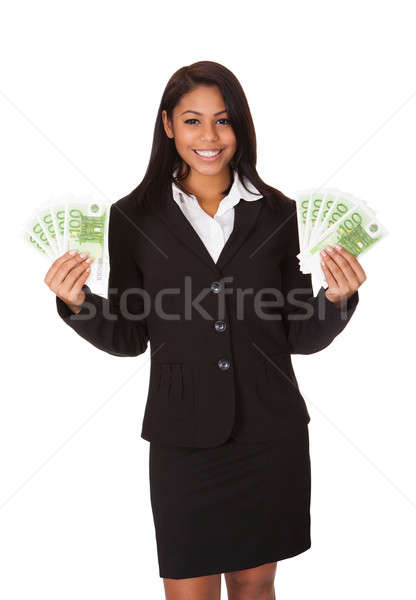 Happy Businesswoman Holding Euro Note In Hand Stock photo © AndreyPopov